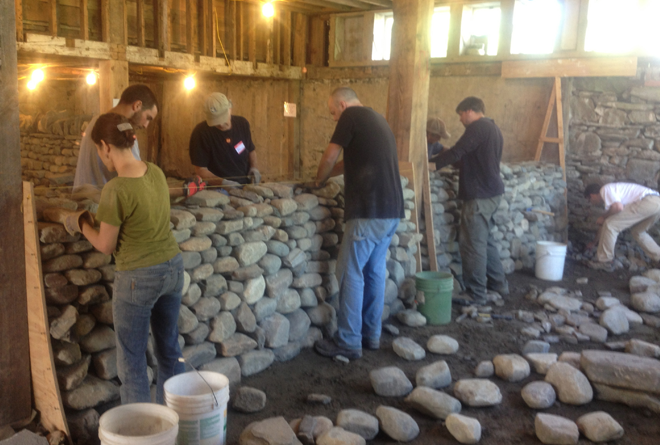 students learning to build a dry stone wall