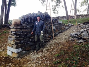 A dry stone wall going up a 20 degree slope built in a Level 2 workshop