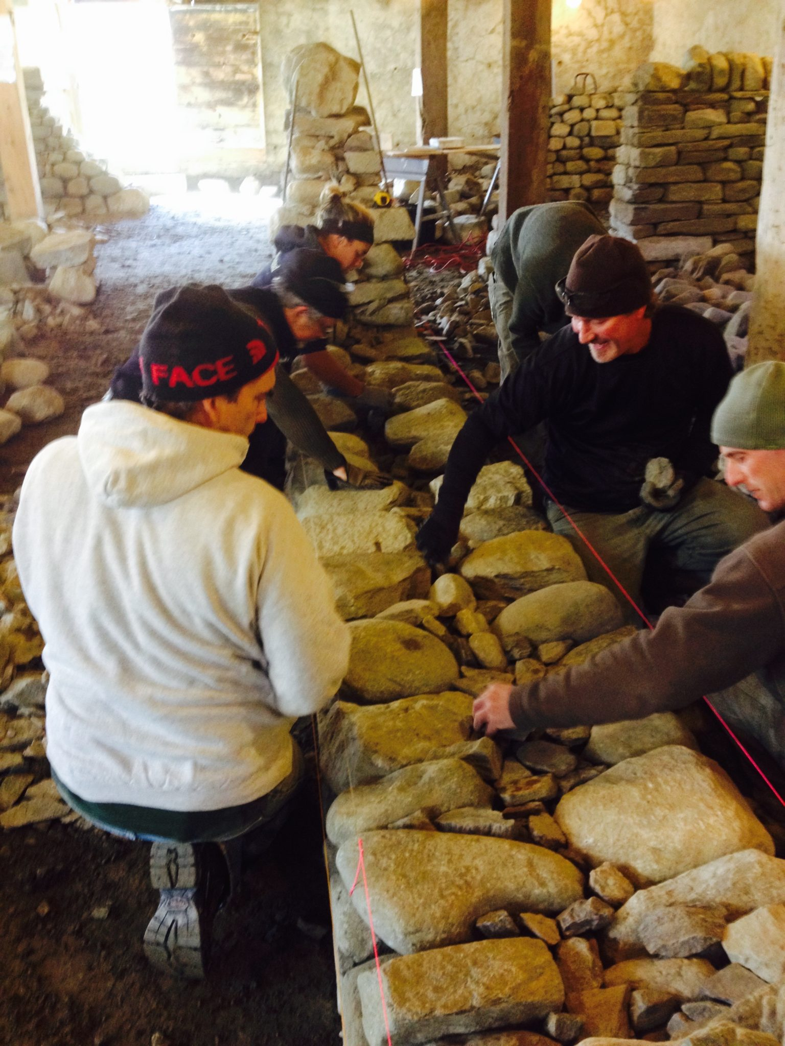 Dry stone walling workshop packing first lift