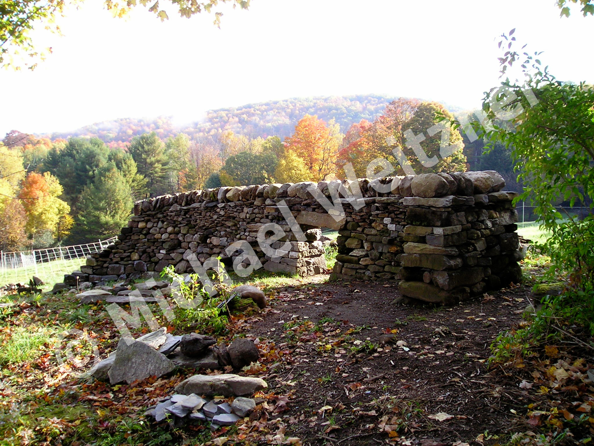 Dry dry stone wall built with numerous features by Michael Weitzner