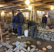 dry stone walling training working on the first lift of the wall