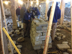 Dry Stone wall head or cheek end being built in contractors workshop