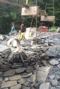 Dry stone wall with rebar and wood frames with moongate started