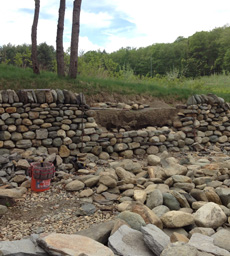 Section of dry stone retaining wall being built
