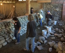 Dry stone wall built in women's workshop with covertness on
