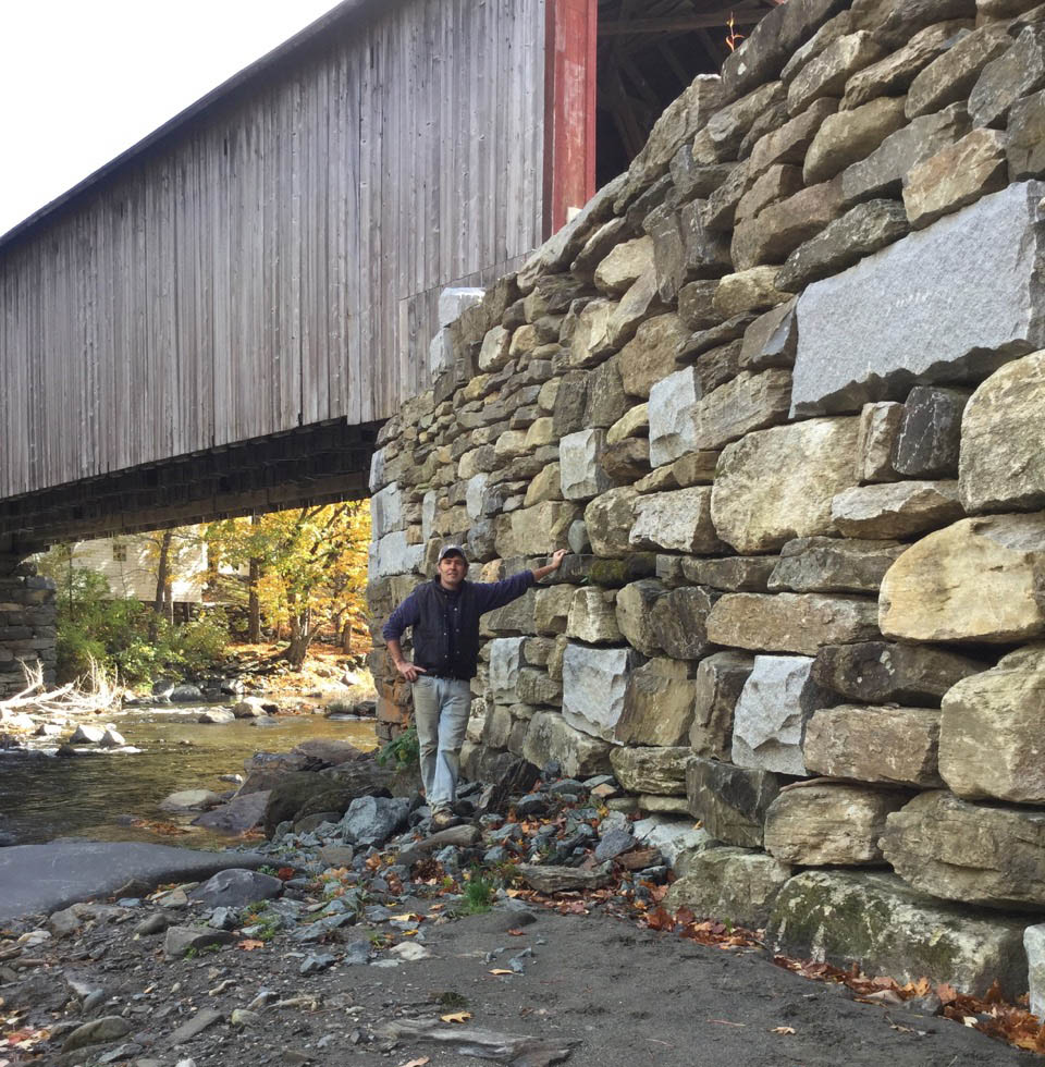 Peter at Green River Bridge wing wall, built with other certified wallers including Jared Flynn and TJ mora