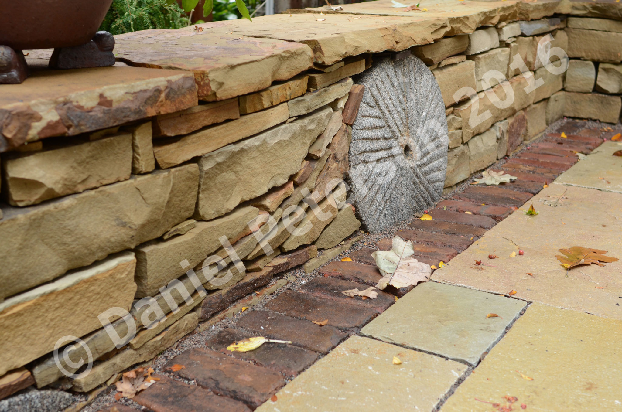 Sandtone Seating Wall With Millstone Autumn 2015 Afternoon The