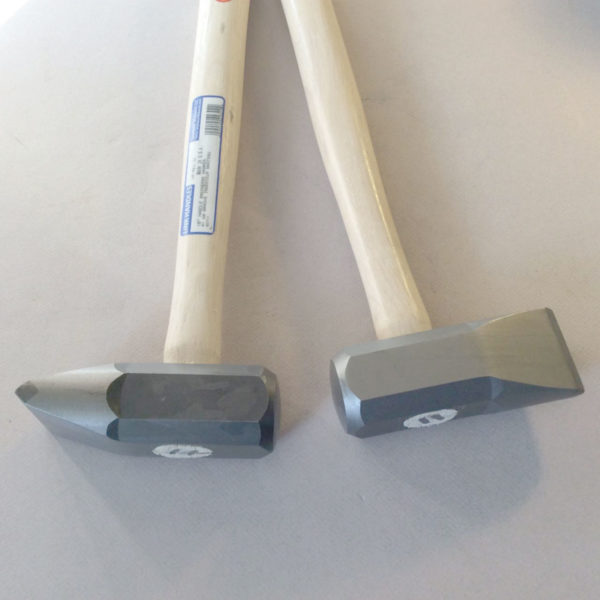 Stone buster set - hammers designed to strike each other