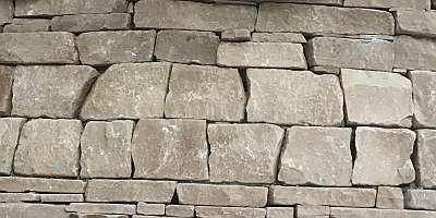Squarish double course of deeper blocks